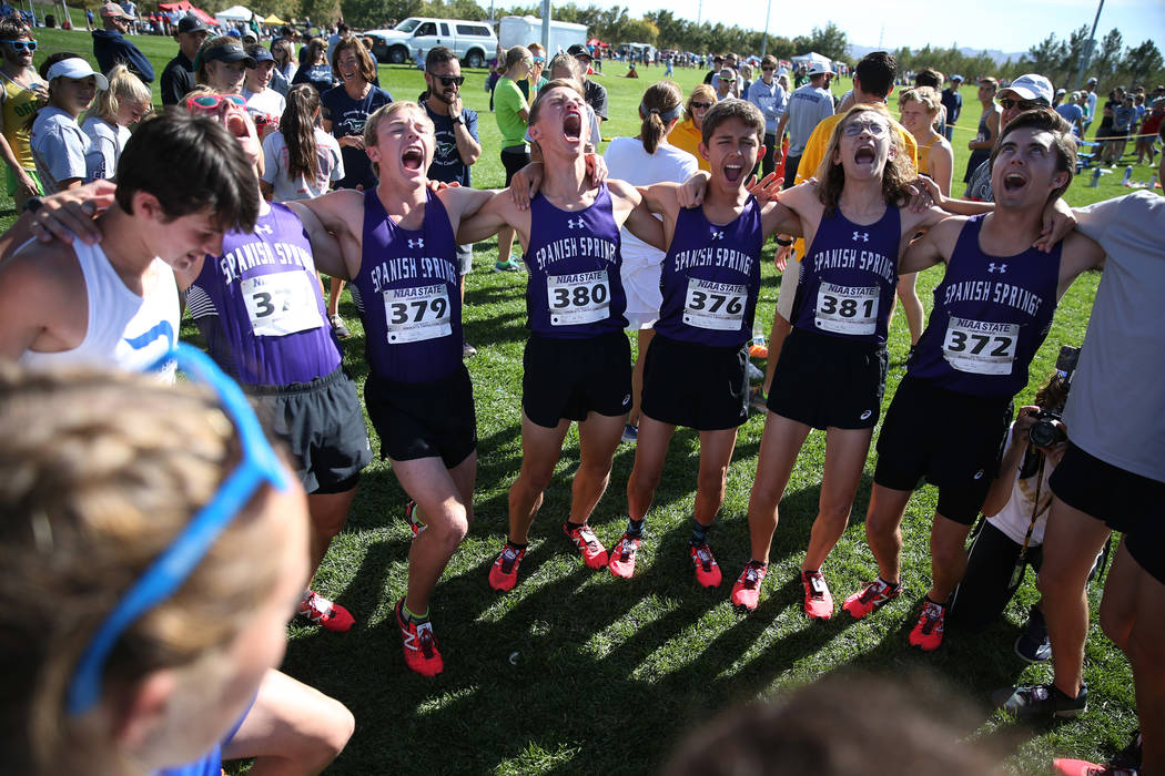 Runners from Spanish Springs High School in Washoe County yell a chant as they get ready to compete during the NIAA 4A Boys Cross Country State Championship at the Veteran's Memorial Park in Bould ...