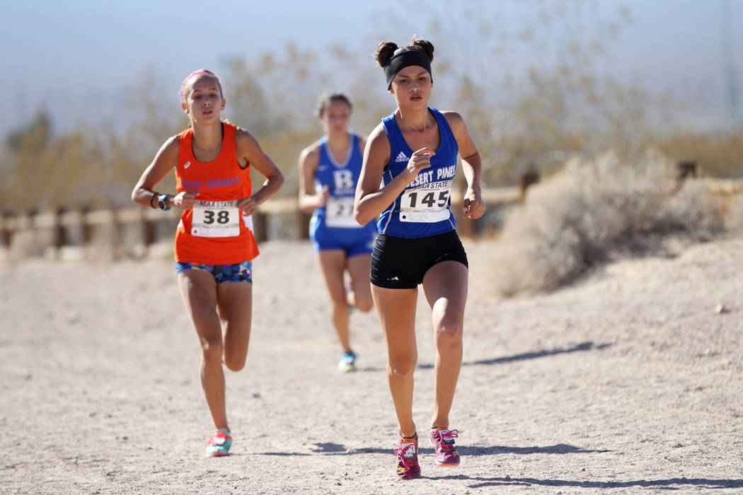 Desert Pines Jazmin Felix (145) runs during the NIAA 4A Girls Cross Country State Championship at the Veteran's Memorial Park in Boulder City, Saturday, Nov. 3, 2018. Felix finished in first place ...
