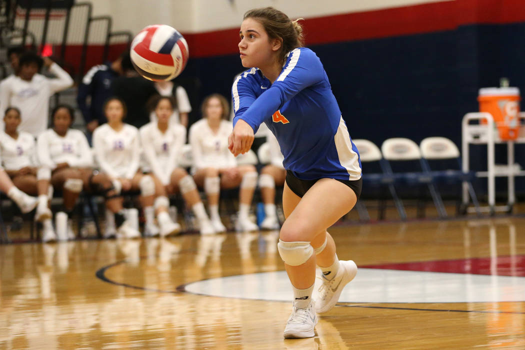 Bishop Gorman's Natalie Mavroidis (4) saves the ball against Palo Verde during the third set of the girl's volleyball game at Coronado High School in Henderson, Saturday, Nov. 3, 2018. Bishop Gorm ...