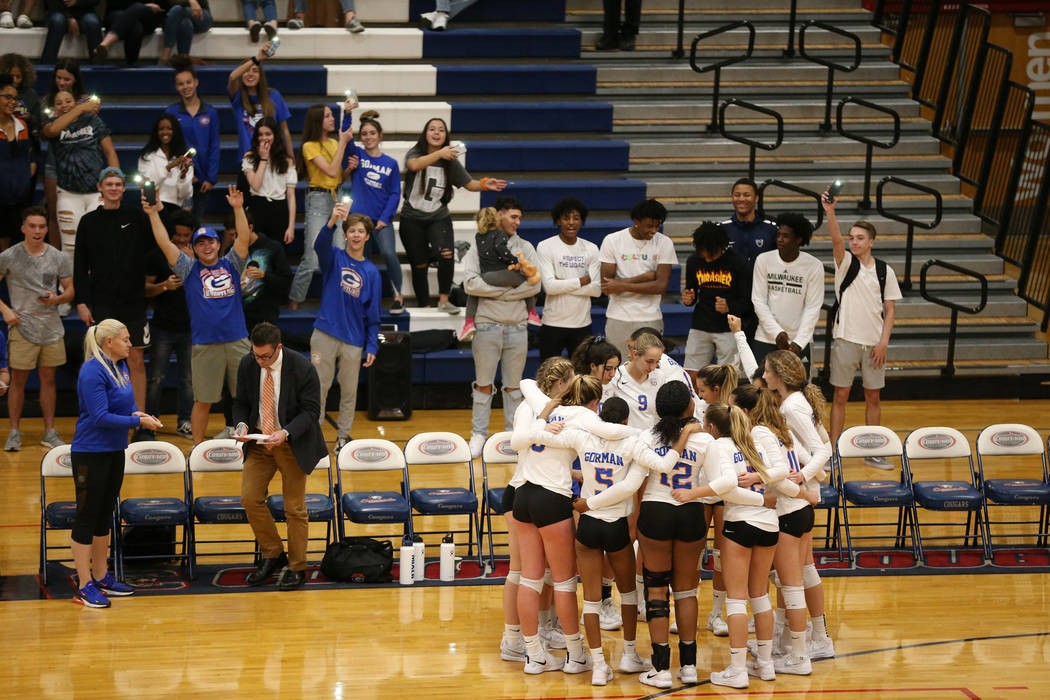 Bishop Gorman players huddle as they get ready for the third set against Palo Verde in the girl's volleyball game at Coronado High School in Henderson, Saturday, Nov. 3, 2018. Bishop Gorman won 3 ...