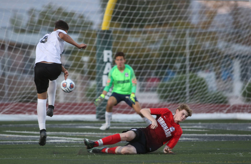 Las Vegas' Sergio Aguayo (18) takes a shot against Coronado's Josue Ruiz during the Southern Nevada boys soccer championship at Rancho High School in Las Vegas, Monday, Nov. 5, 2018. Caroline Breh ...