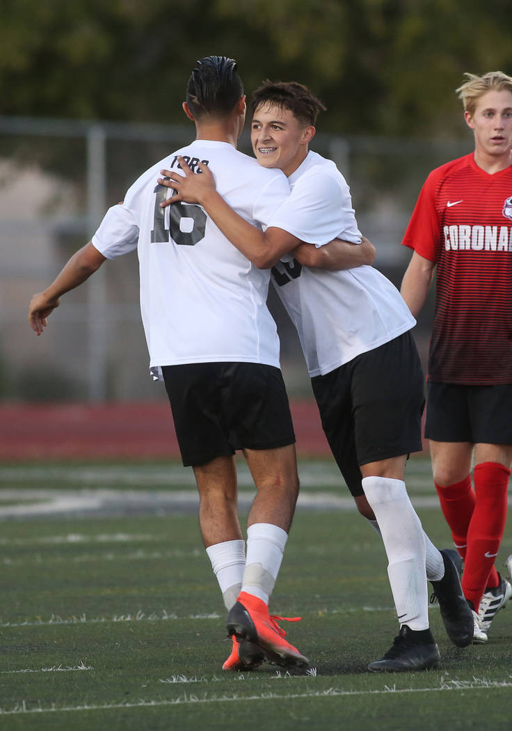 Las Vegas' Sergio Aguayo (18) celebrates with Nathan Zamora (16) after scoring against Coronado during the Southern Nevada boys soccer championship at Rancho High School in Las Vegas, Monday, Nov. ...