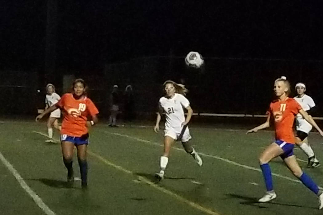 Bishop Gorman's marissa Garcia (19) and Michelle Madrid (11) and Faith Lutheran's Adilyn Radwanski (21) go after a loose ball during the Southern Nevada championship game on Monday, Nov. 6, 2018 a ...