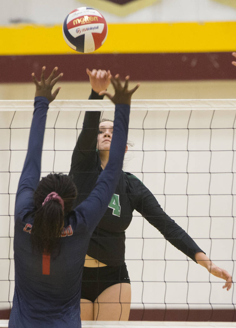 Palo Verde senior Elizabeth Gutierrez (14) spikes the ball over Coronado sophomore Morenike Ajayi (1) during the Class 4A state volleyball quarterfinal on Monday, November 5, 2018, at Eldorado Hig ...