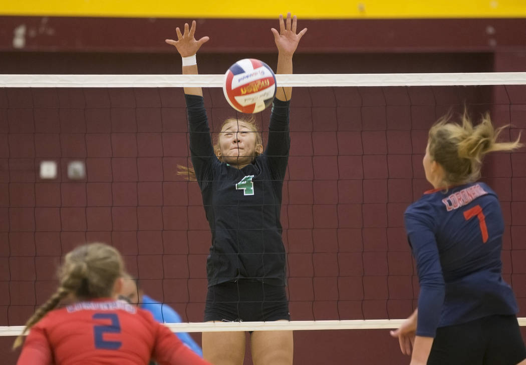 Palo Verde freshman Kaila Yang (4) tries to block the shot of Coronado sophomore Cassandra Smits-Van Oyen (7) during the Class 4A state volleyball quarterfinal on Monday, November 5, 2018, at Eldo ...