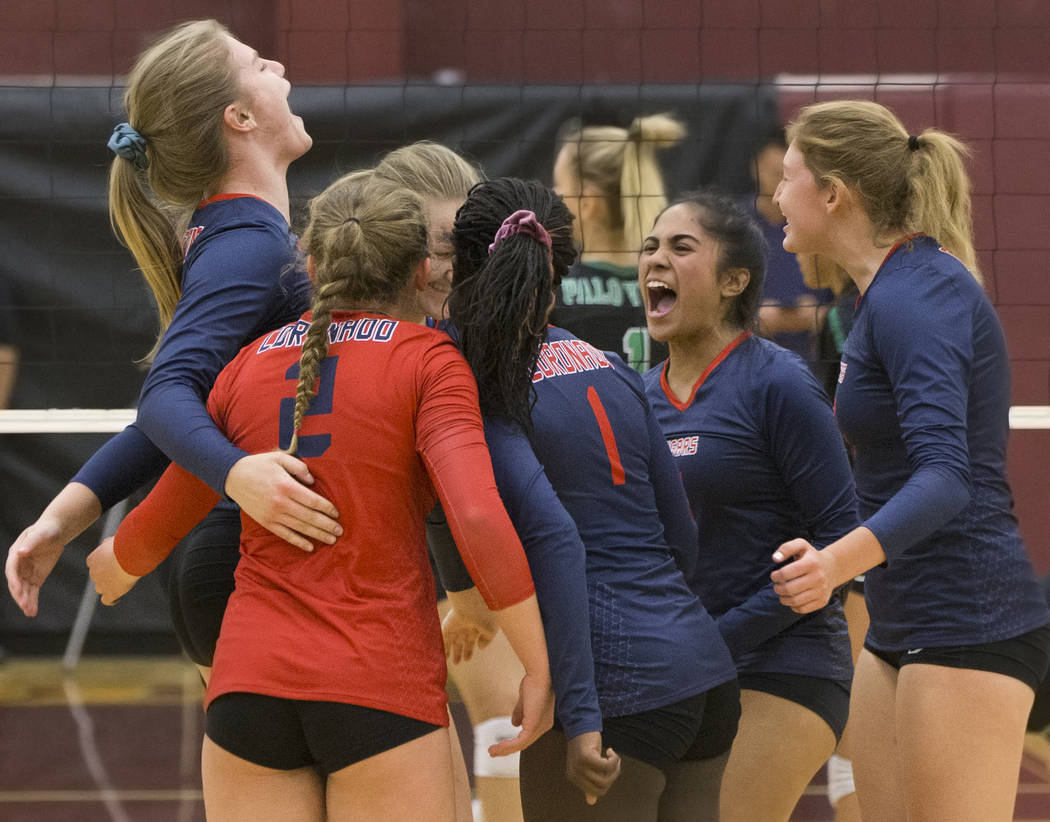 Coronado junior Dallas Balanay-Flores (3) celebrates with teammates after winning a point during the Class 4A state volleyball quarterfinal on Monday, November 5, 2018, at Eldorado High School, in ...
