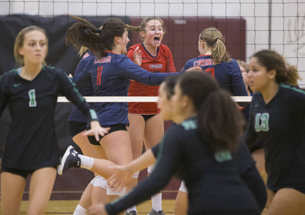 Coronado, top, celebrates after winning the second set against Palo Verde during the Class 4A state volleyball quarterfinal on Monday, November 5, 2018, at Eldorado High School, in Las Vegas. Benj ...