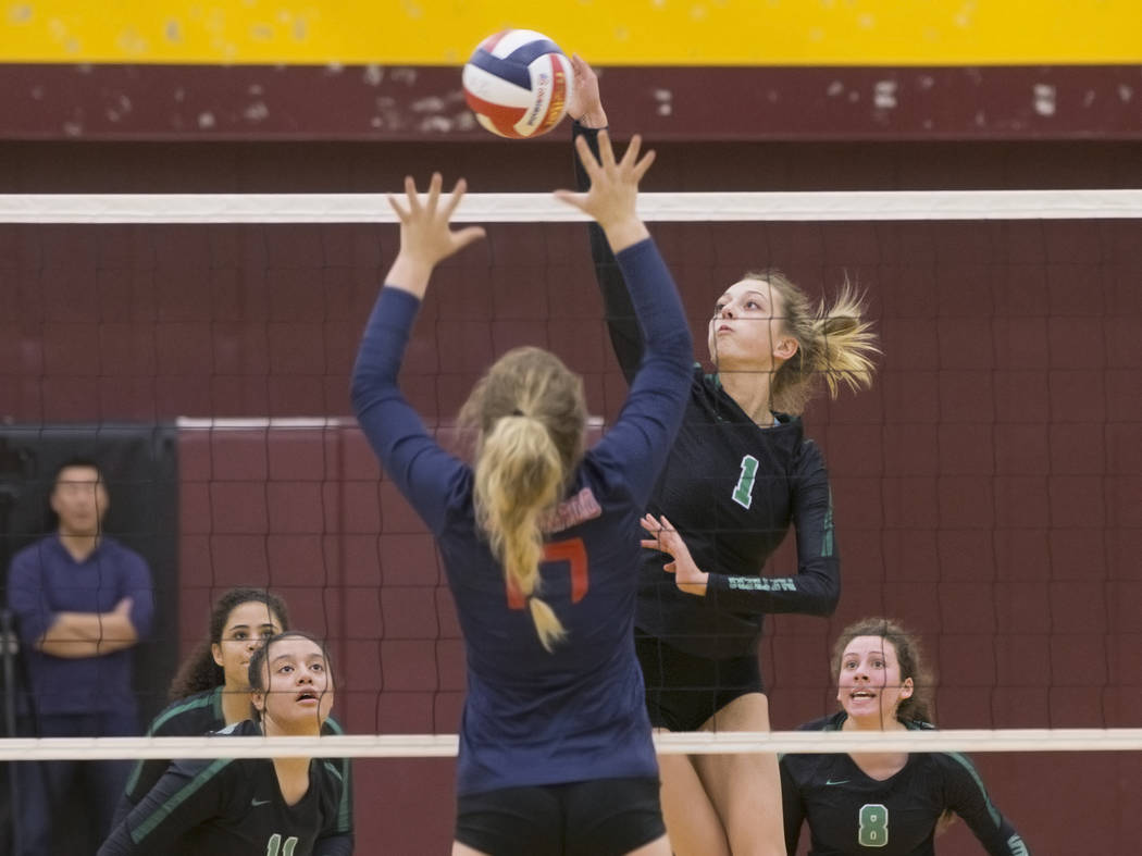 Palo Verde sophomore Haley Bringhurst (1) spikes the ball over Coronado senior Riley Froman (17) during the Class 4A state volleyball quarterfinal on Monday, November 5, 2018, at Eldorado High Sch ...