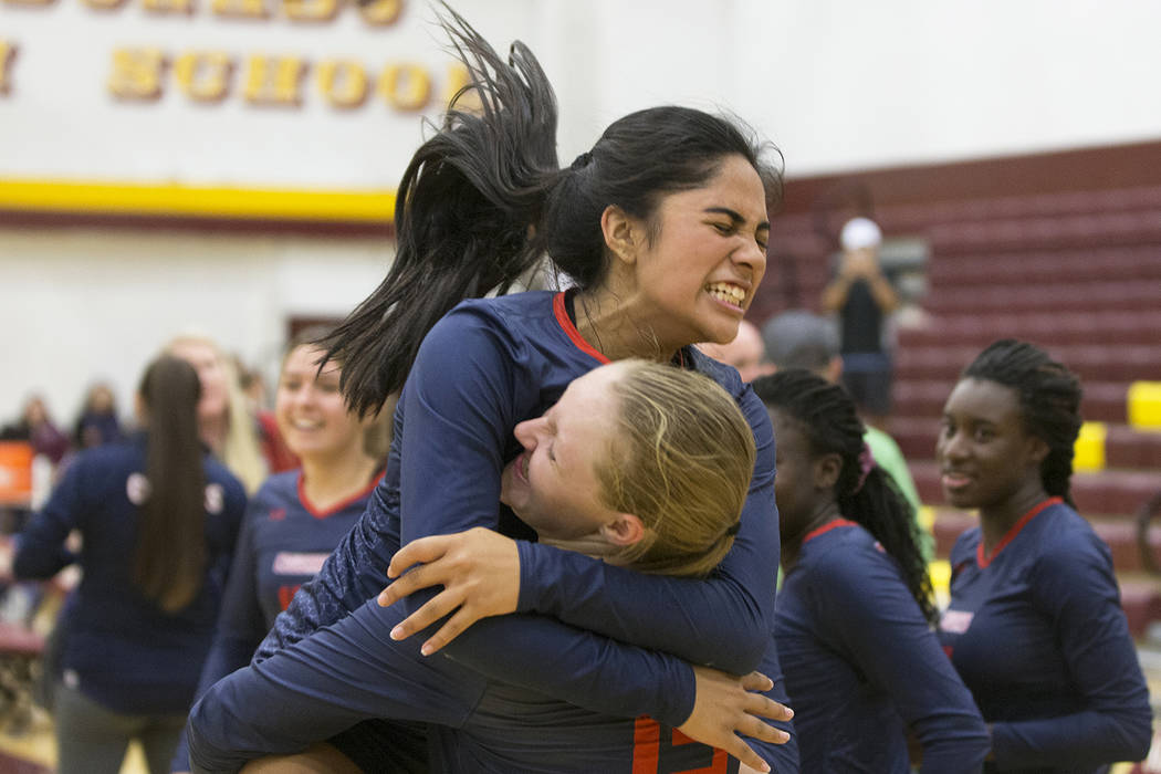 Coronado junior Dallas Balanay-Flores (3) celebrates with teammate Ashlynn Ammerman (13) after defeating Palo Verde during the Class 4A state volleyball quarterfinal on Monday, November 5, 2018, a ...