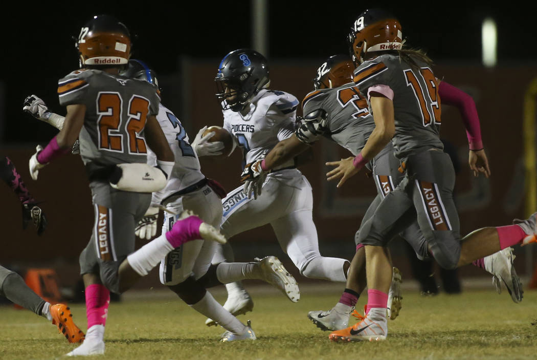 Canyon Springs' Jayvioin Pugh (3) runs the ball during the first half of a football game at Legacy High School in North Las Vegas on Thursday, Oct. 25, 2018. Chase Stevens Las Vegas Review-Journal ...
