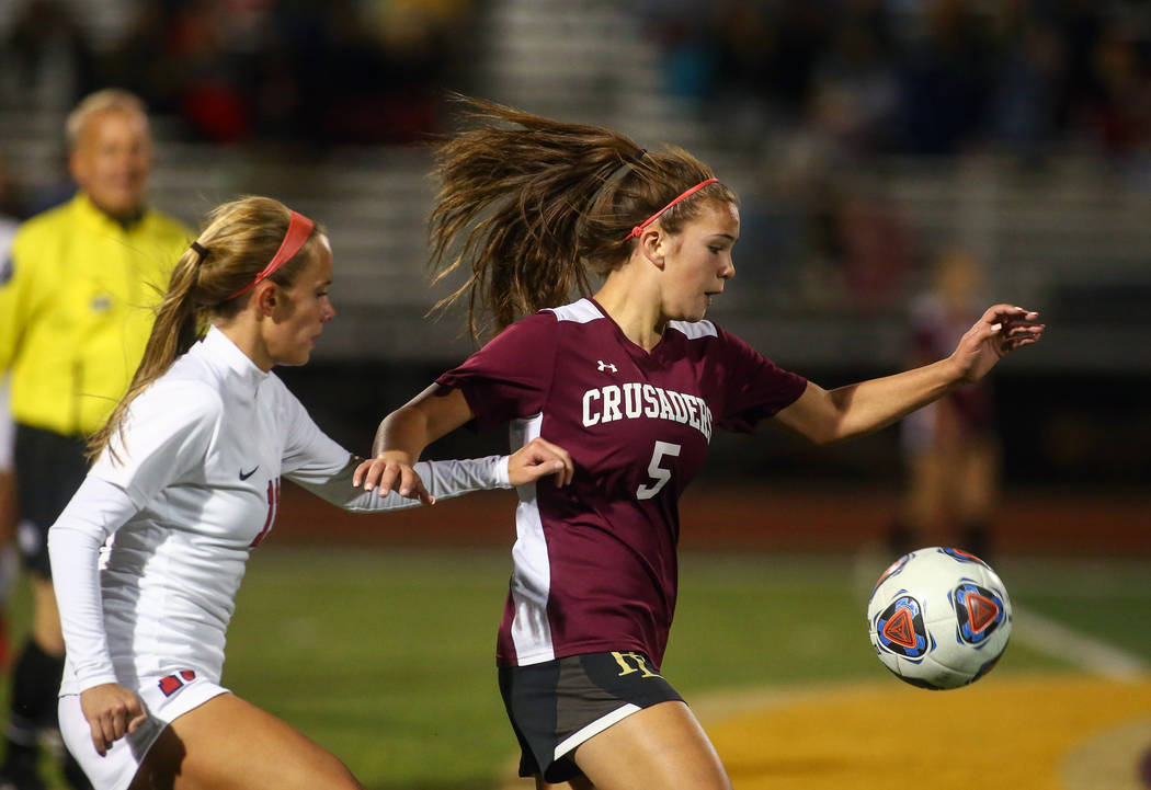 Faith Lutheran's Bowers (5) runs towards the ball while being covered by Coronado's Heather Mitchell (11) during the state quarterfinal game at Faith Lutheran High School in Las Vegas, Thursday, N ...
