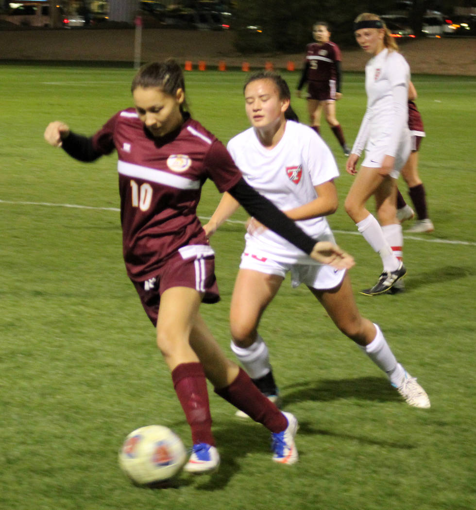 Pahrump Valley's Sofia Castro dribbles past Truckee's Carly Davis in the Class 3A state soccer semifinals on Friday at Bettye Wilson Soccer Complex. (Tim Guesman/Las Vegas Review-Journal)