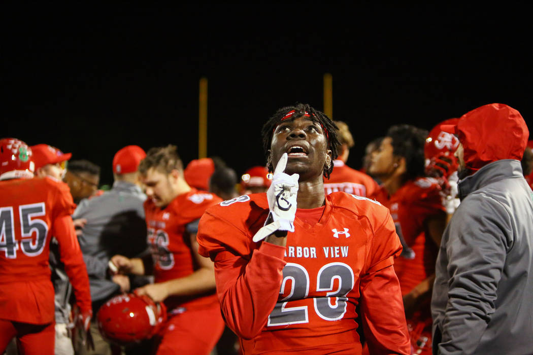 Arbor View's Darius Harrison (23) celebrates the win over Desert Pines during second half of the Mountain Region football semifinal game at Arbor View High School in Las Vegas, Friday, Nov. 9, 201 ...