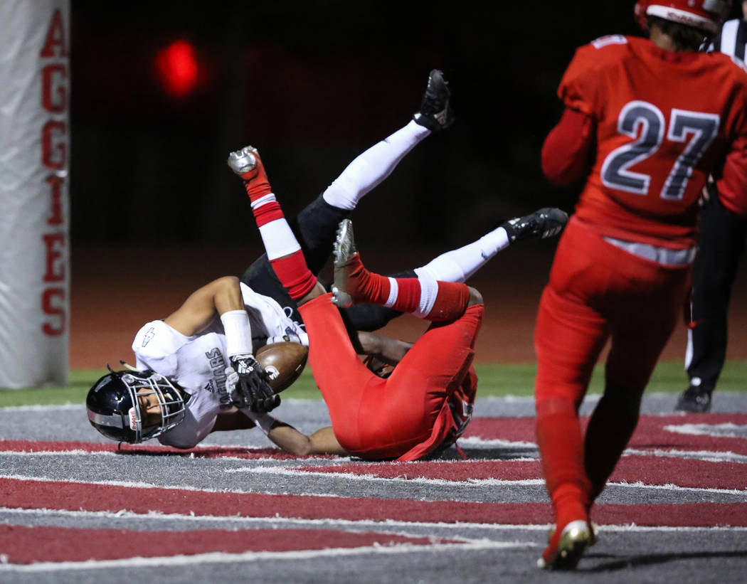 Arbor View's Rickie Davis (20) blocks Desert Pines' Branden Thomas (4) from catching the ball in the end zone during second half of the Mountain Region football semifinal game at Arbor View High S ...