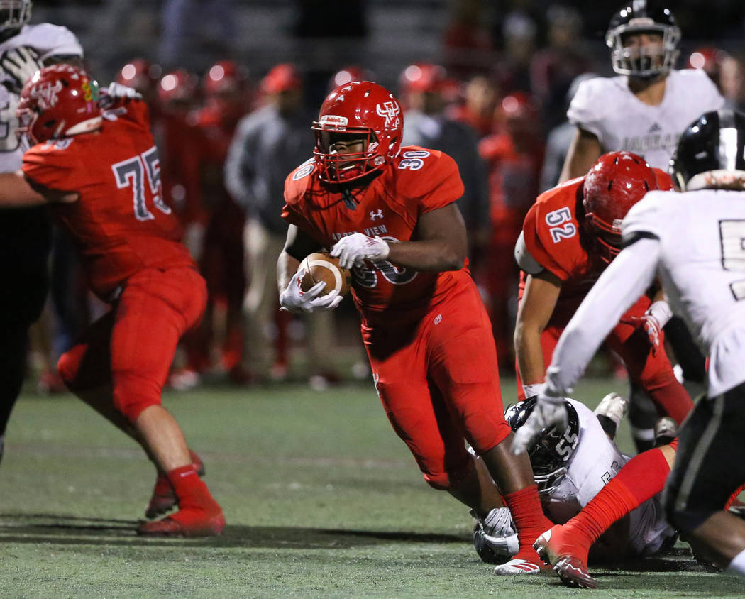 Arbor View's Darius Williams (30) runs through a pocket during second half of the Mountain Region football semifinal game at Arbor View High School in Las Vegas, Friday, Nov. 9, 2018. Caroline Bre ...