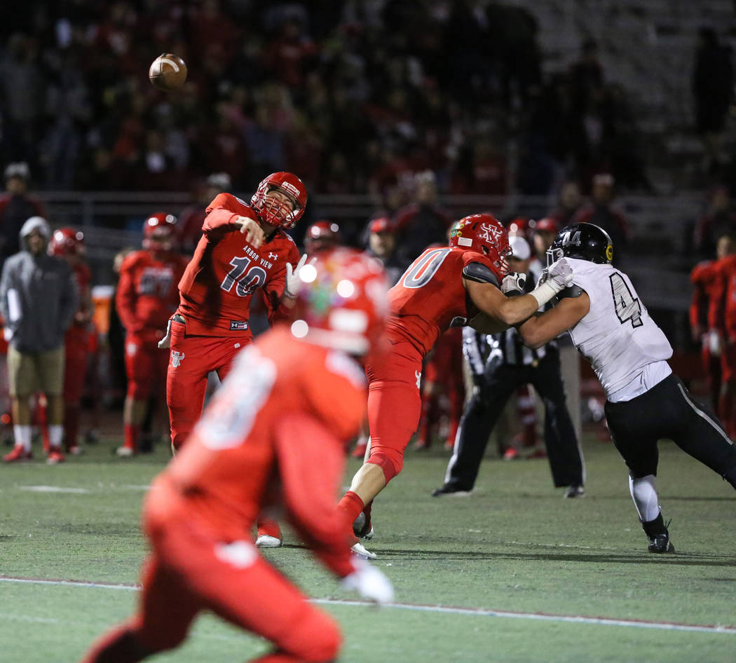 Arbor View's Logan Bollinger (10) passes the ball to Arbor View's Darius Harrison (23) during second half of the Mountain Region football semifinal game at Arbor View High School in Las Vegas, Fri ...