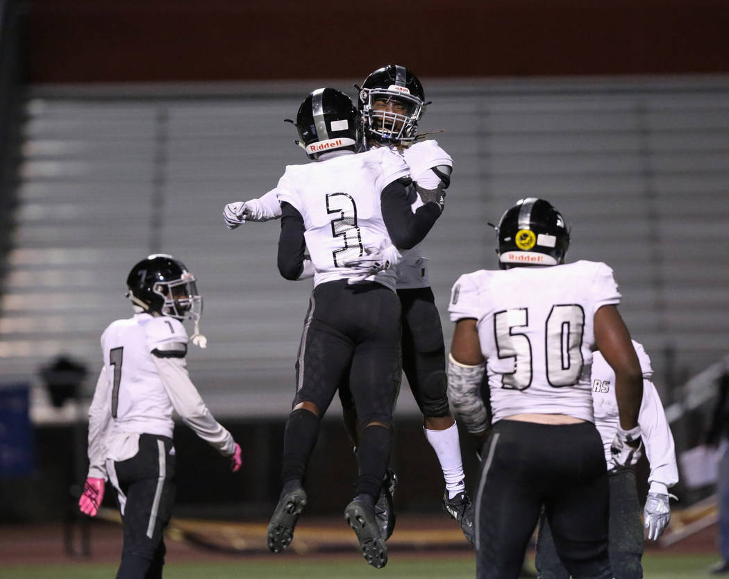 Desert Pines' Jamel Brown (3) and Desert Pines' Darius Stewart (5) celebrate after scoring a touchdown against Arbor View during second half of the Mountain Region football semifinal game at Arbor ...
