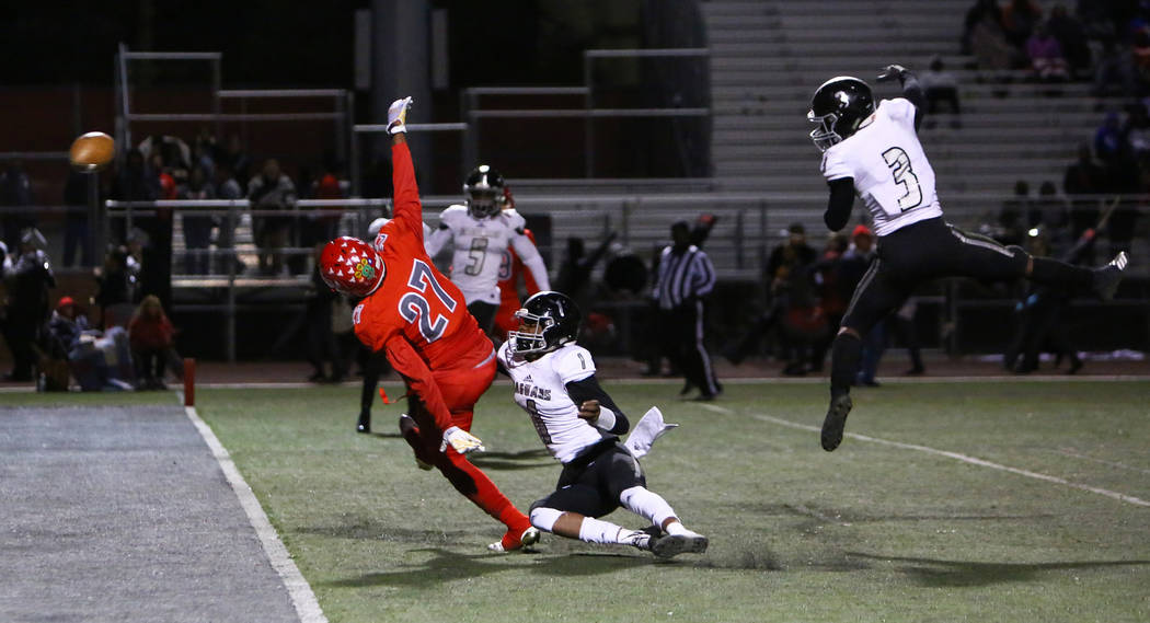 Arbor View's Niles Scafati-Boyce (27) misses a pass while being covered by Desert Pines' Tyler Williamson (1) and Desert Pines' Jamel Brown (3) during second half of the Mountain Region football s ...