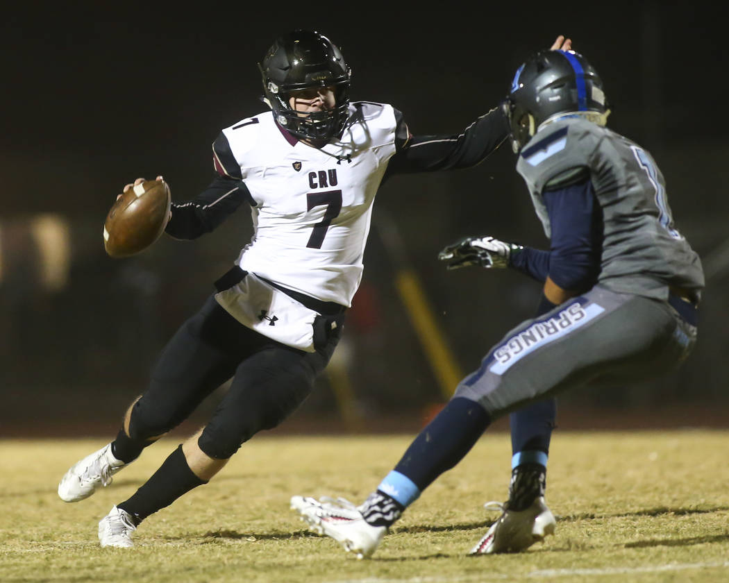 Faith Lutheran's Sagan Gronauer (7) looks to get past Canyon Springs' Gianni Blackwell (1) during a Mountain Region football semifinal game at Canyon Springs High School in North Las Vegas on Frid ...