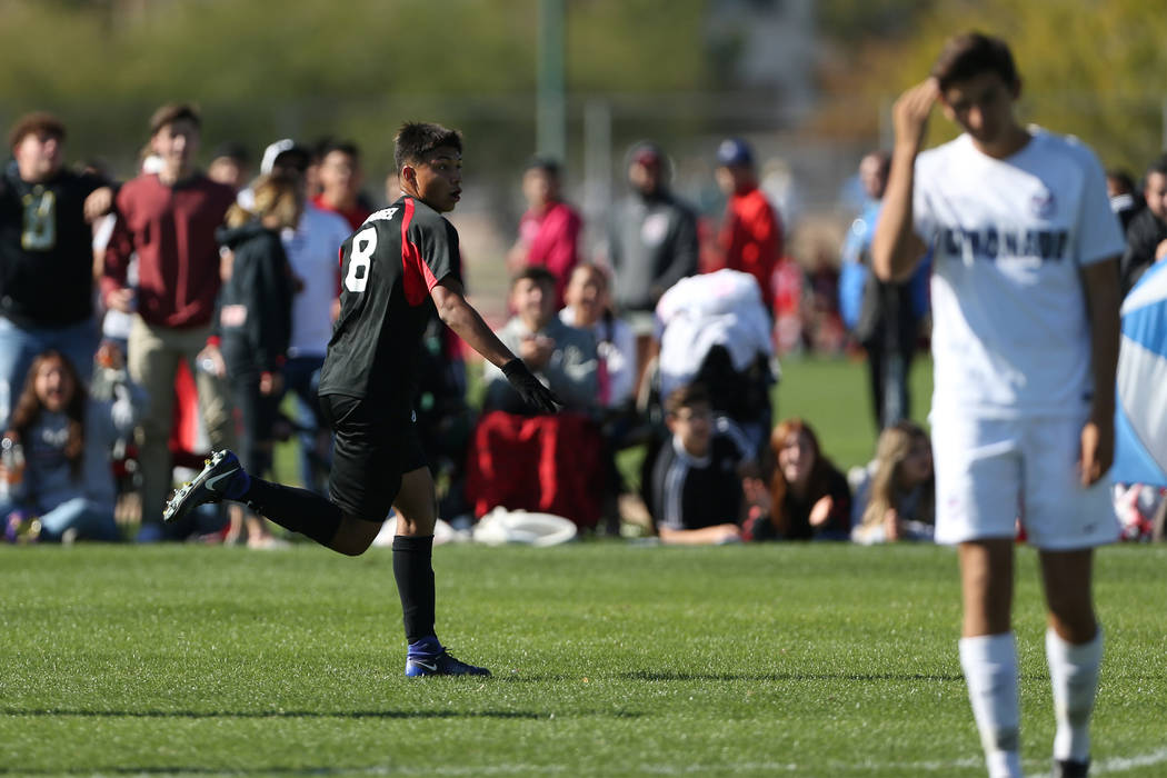 Las Vegas' Daniel Rangel (8) celebrates his score during the second half against Coronado in the 4A boys state soccer championship game at the Bettye Wilson Soccer Complex in Las Vegas, Saturday, ...
