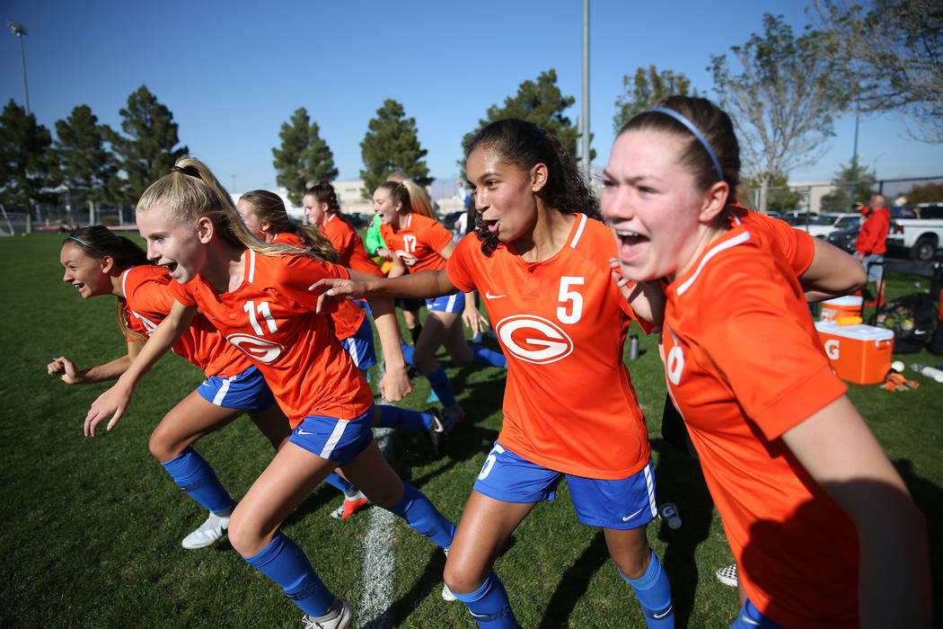 Bishop Gorman players run onto the field in celebration of their 4-0 win against Galena in the 4A girls state soccer championship game at the Bettye Wilson Soccer Complex in Las Vegas, Saturday, N ...