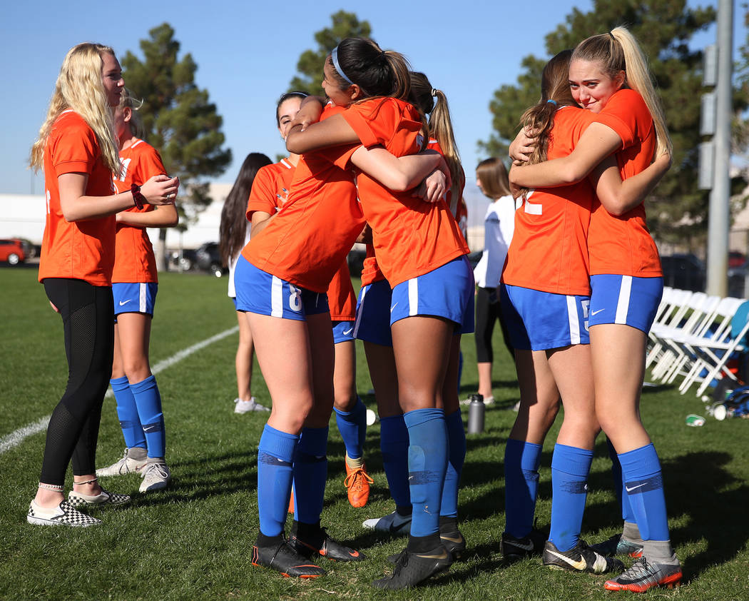 Bishop Gorman players hug before the final whistle for their 4-0 win against Galena in the 4A girls state soccer championship game at the Bettye Wilson Soccer Complex in Las Vegas, Saturday, Nov. ...