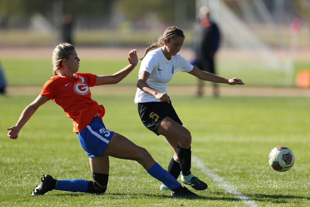 Bishop Gorman's Gianna Gourley (30) shoots for a score under pressure from Galena's Shea Sundali (5) during the second half of the 4A girls state soccer championship game at the Bettye Wilson Socc ...