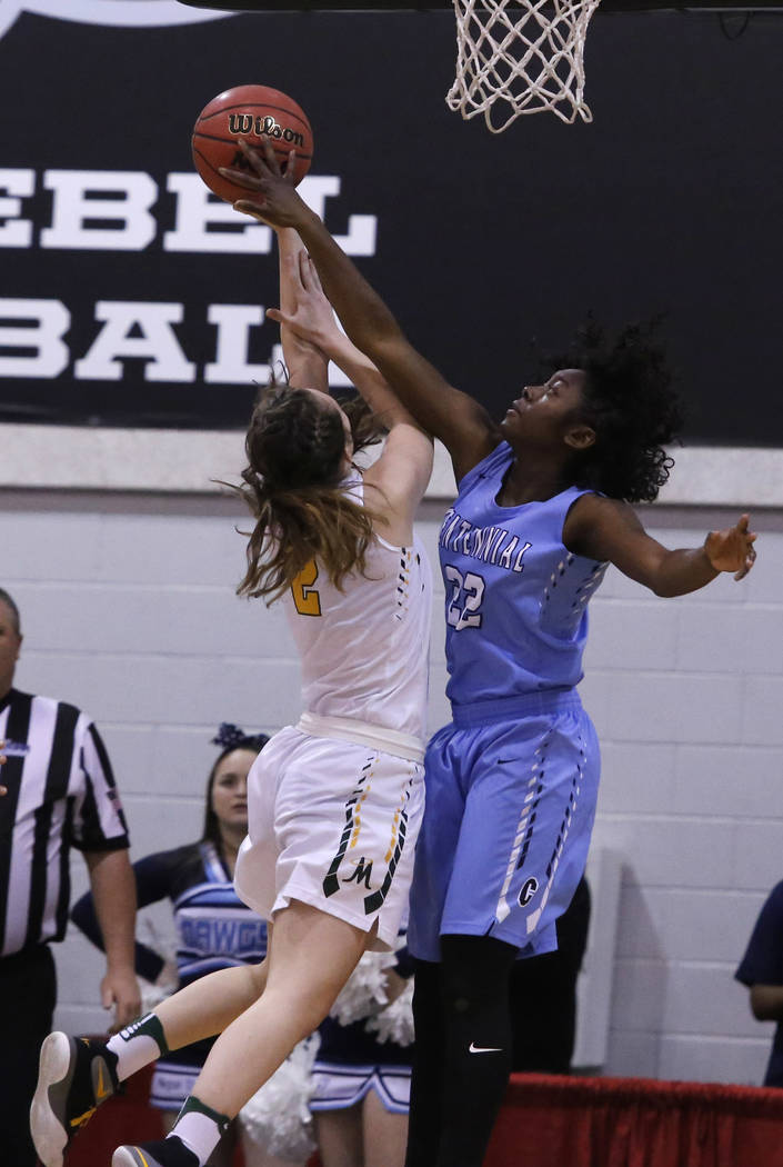 Centennial's Eboni Walker (22) blocks a shot from Bishop Manogue's Maddie Camacho (2) during the first half of a Class 4A girls state final game at the Cox Pavillion on Friday, Feb. 24, 2017, in L ...