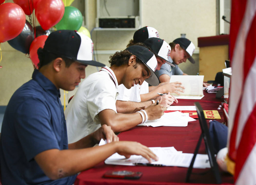Desert Oasis baseball players, Aaron Roberts, left, and DJ Jefferson, join their teammates in signing letters of intent at Desert Oasis High School in Las Vegas on Wednesday, Nov. 14, 2018. Robert ...