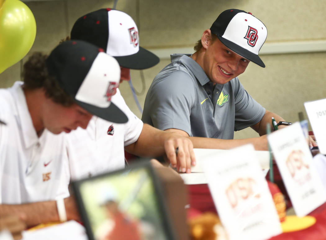 Desert Oasis baseball player Parker Schmidt joins teammates in signing letters of intent at Desert Oasis High School in Las Vegas on Wednesday, Nov. 14, 2018. Schmidt signed a letter of intent for ...