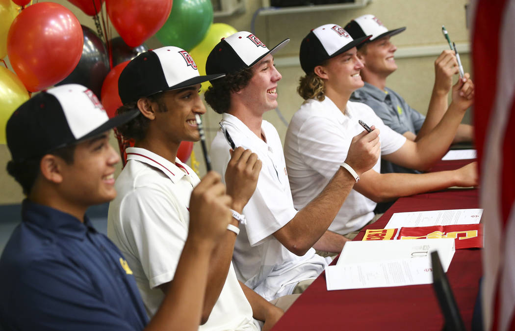 Desert Oasis baseball players, from left, Aaron Roberts, DJ Jefferson, Campbell Holt, Josh Sharman and Parker Schmidt pose during signing day at Desert Oasis High School in Las Vegas on Wednesday, ...
