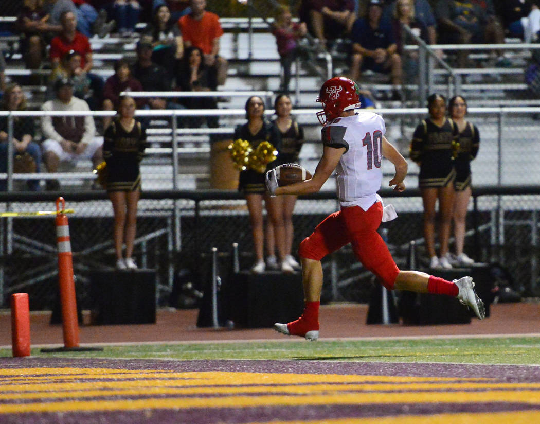 Arbor View quarterback Logan Bollinger (10) scores a touchdown during the first half of a game against Faith Lutheran at Faith Lutheran in Las Vegas on Friday, Oct. 5, 2018. Arbor View won 10-7. B ...
