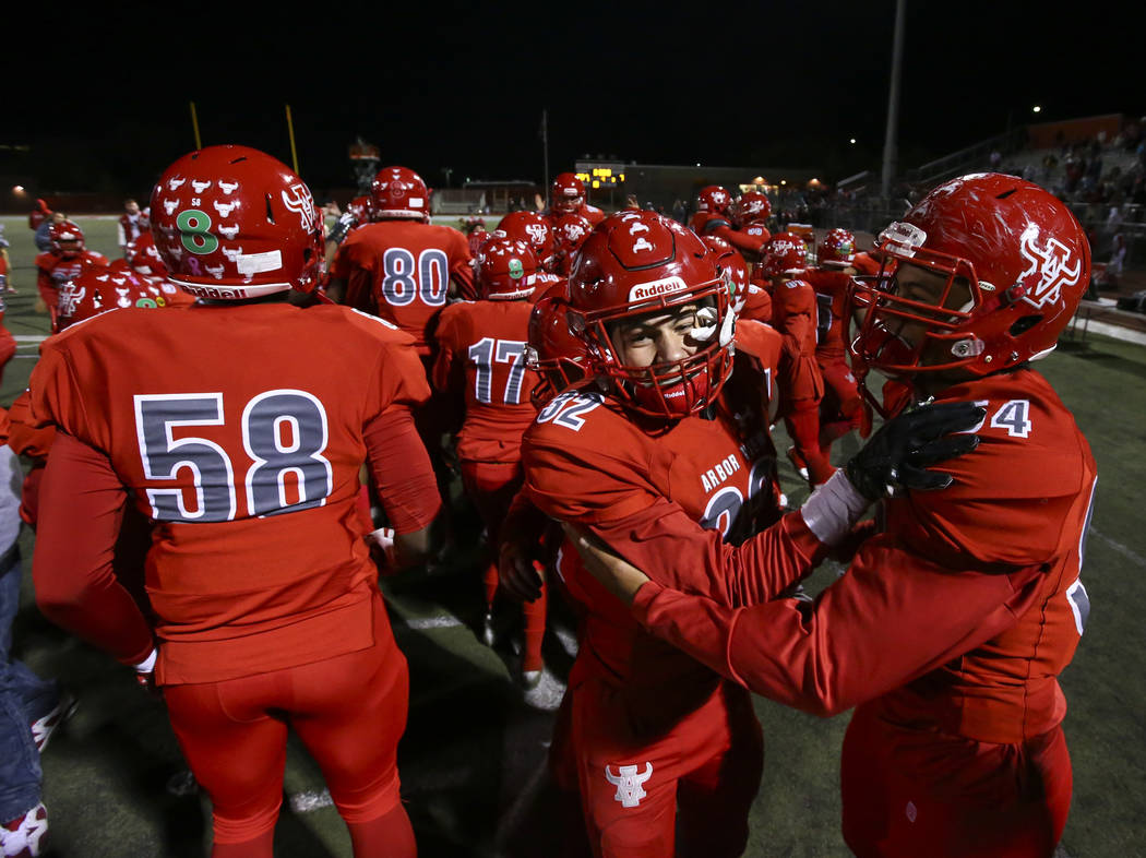 Arbor View's Tai Tuinei (54) and Josh Perez (32) celebrate their win over Faith Lutheran in the Class 4A Mountain Region championship game at Arbor View High School in Las Vegas on Friday, Nov. 16 ...