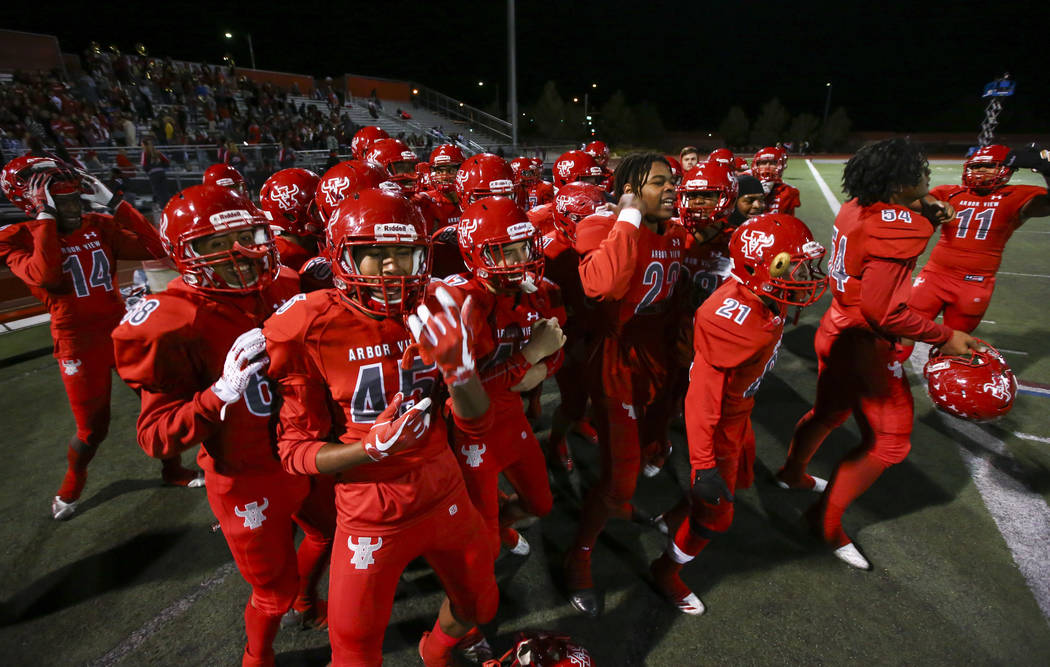 Arbor View players celebrate their win as the clock counts down in the Class 4A Mountain Region championship game against Faith Lutheran at Arbor View High School in Las Vegas on Friday, Nov. 16, ...