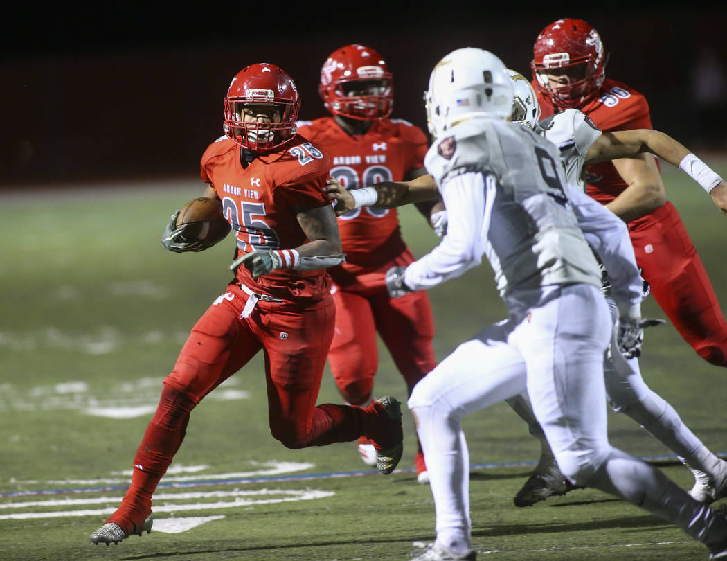 Arbor View's Kyle Graham (25) runs the ball against Faith Lutheran during the second half of the Class 4A Mountain Region championship game at Arbor View High School in Las Vegas on Friday, Nov. 1 ...