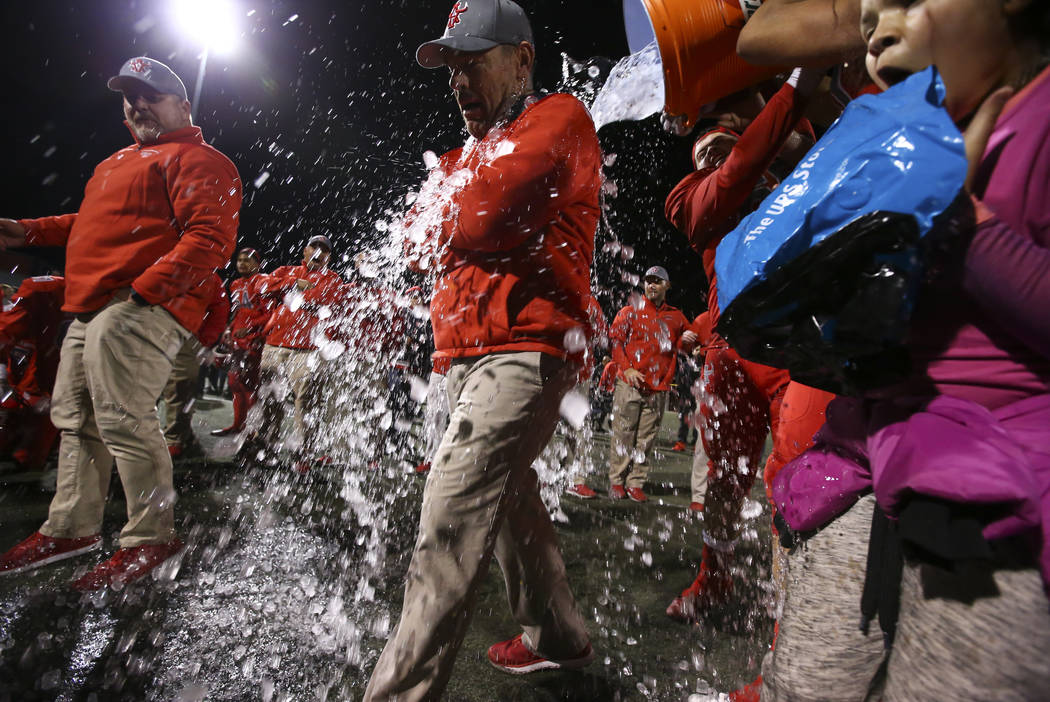 Players dump ice onto Arbor View head coach Dan Barnson while celebrating their win over Faith Lutheran in the Class 4A Mountain Region championship game at Arbor View High School in Las Vegas on ...