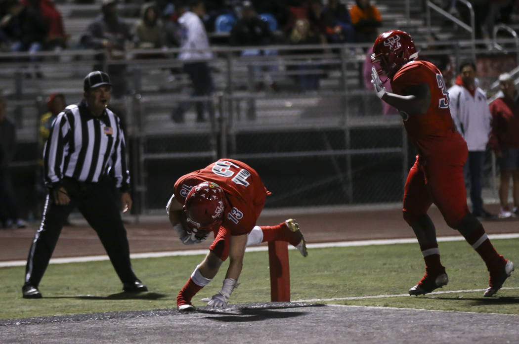Arbor View's Justin Hausner (13) dives into the end zone to score against Faith Lutheran during the second half of the Class 4A Mountain Region championship game at Arbor View High School in Las V ...