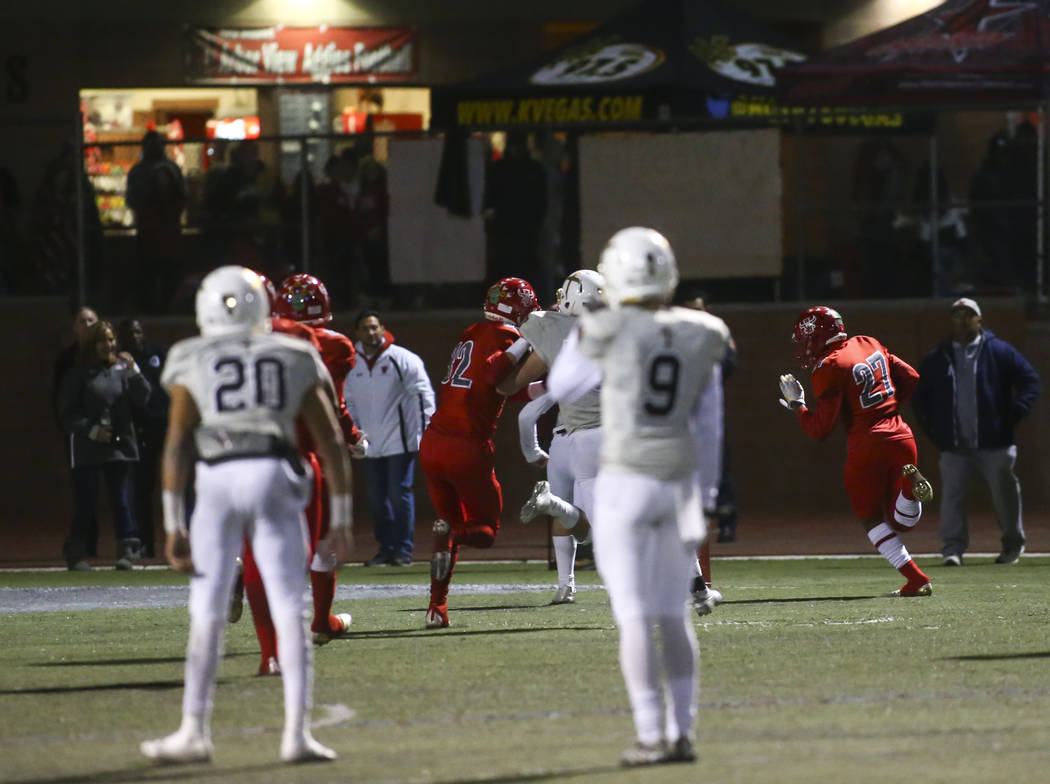 Arbor View's Niles Scafati-Boyce (27) runs the ball on an interception to score a touchdown against Faith Lutheran during the first half of the Class 4A Mountain Region championship game at Arbor ...