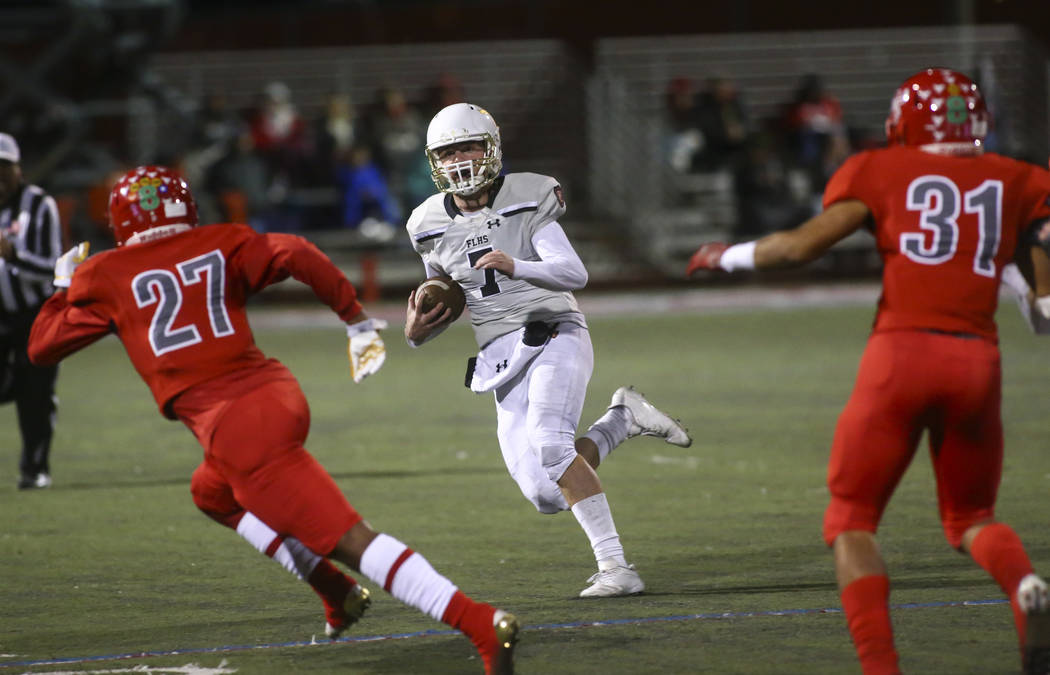 Faith Lutheran's Sagan Gronauer (7) runs the ball against Arbor View during the first half of the Class 4A Mountain Region championship game at Arbor View High School in Las Vegas on Friday, Nov. ...