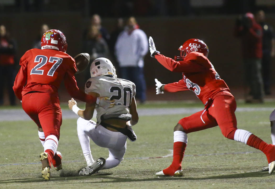 Arbor View's Niles Scafati-Boyce (27) reaches out to intercept a pass intended for Faith Lutheran's Gregory Oliver (20) during the first half of the Class 4A Mountain Region championship game at A ...