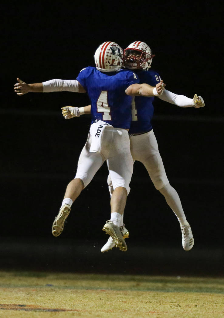 Liberty's Kyle Beaudry (4) and Liberty's Lehi Ausage (24) celebrate after a touchdown is scored against Sierra Vista during the second period of a Desert Region semifinal game at Liberty High Scho ...