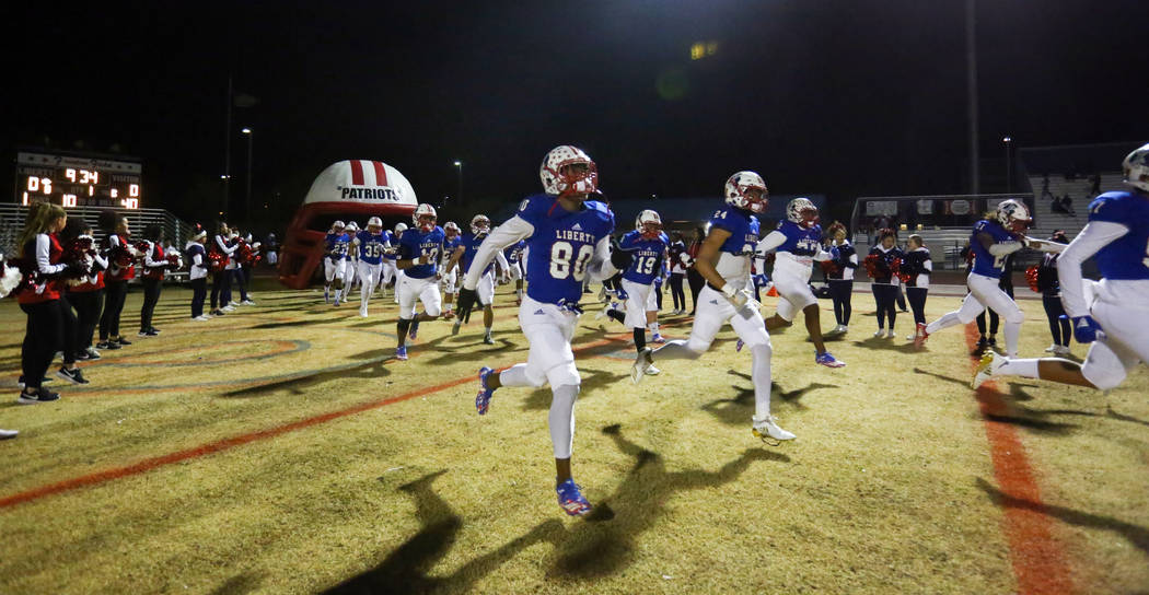 Liberty runs out on the field to mark the start of the game against Sierra Vista during a Desert Region semifinal game at Liberty High School in Las Vegas, Friday, Nov. 16, 2018. Caroline Brehman/ ...