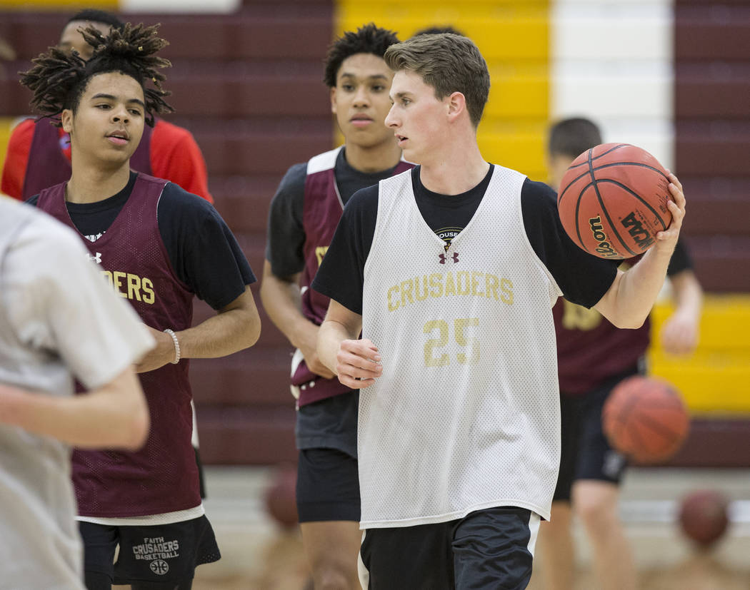 Faith Lutheran senior guard Brevin Walter, right, runs through a drill during practice on Monday, Nov. 19, 2018, at Faith Lutheran High School, in Las Vegas. Benjamin Hager Las Vegas Review-Journal
