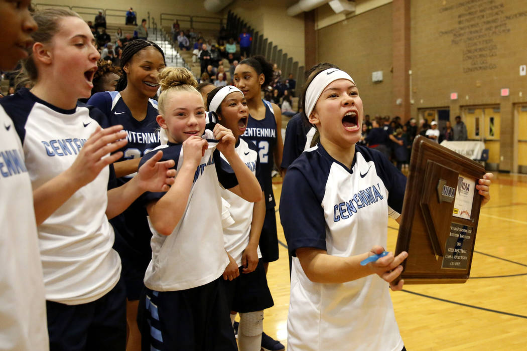 Centennial's Melanie Isbell, right, celebrates with her team after beating Spring Valley during the Sunset Region girls basketball championship at Legacy High School in North Las Vegas on Saturday ...