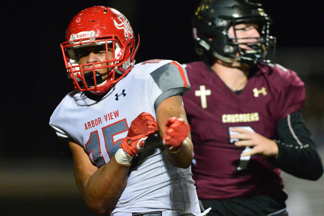 Arbor View's Billy Davis (15) celebrates a sack on Faith Lutheran's Sagan Gronauer (7) in the first half of a game at Faith Lutheran in Las Vegas on Friday, Oct. 5, 2018. Arbor View leads at halft ...