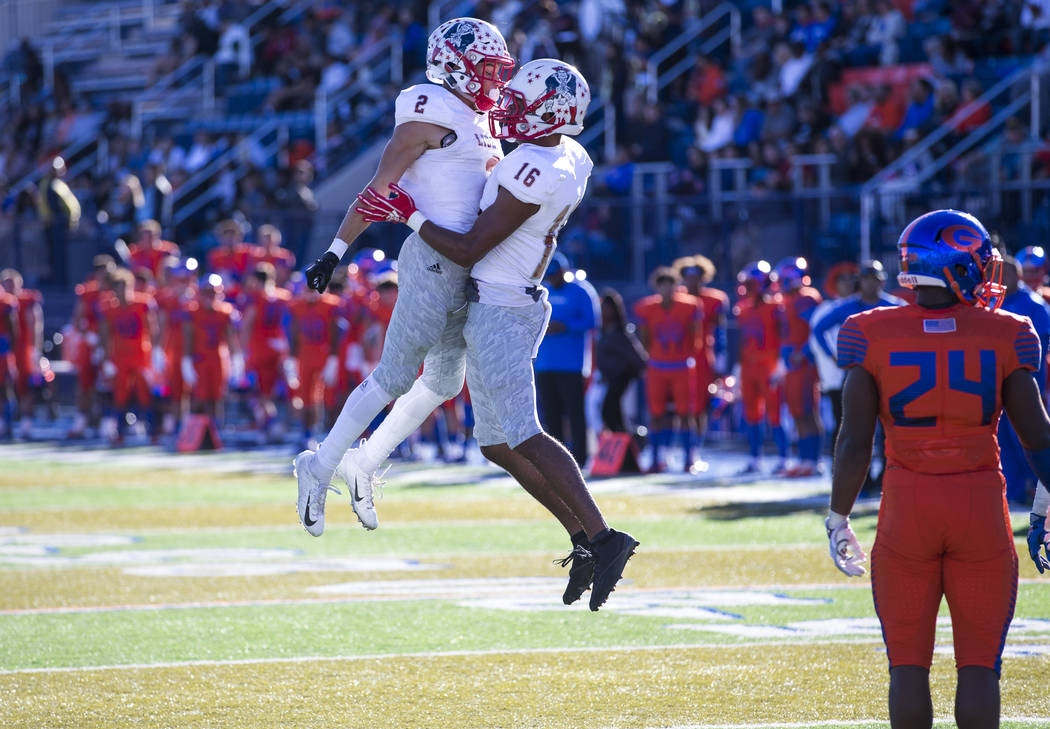 Liberty wide receiver Maurice Hampton (16) celebrates with David Elder (2) after scoring a touchdown against Bishop Gorman during the first half of the NIAA 4A Desert Region championship game at B ...