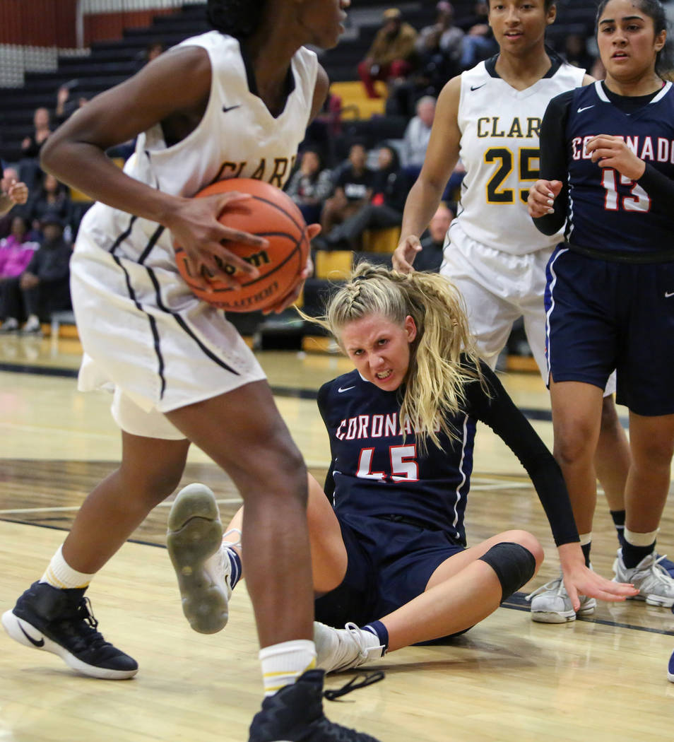 Coronado's Haley Morton (45) falls back on the ground while Clark's Al'ynnay Godfrey (24) is in the possession of the ball during a basketball game at Clark High School in Las Vegas, Monday, Nov. ...