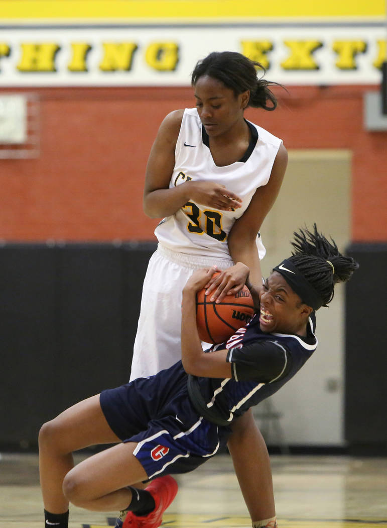 Coronado's Tia Thornton (11) fights for the ball against Clark's Julia Reid (30) during a basketball game at Clark High School in Las Vegas, Monday, Nov. 26, 2018. Caroline Brehman/Las Vegas Revie ...