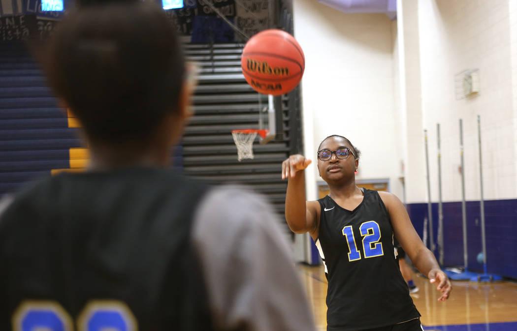 Shania Harper (12), a senior forward on the Sierra Vista High School varsity basketball team, practices drills with teammate Ajanae Cressey (22) at Sierra Vista High School in Las Vegas, Monday, N ...