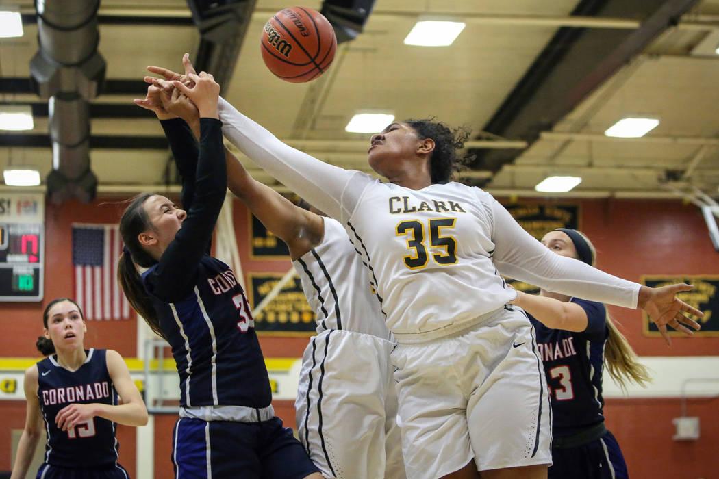 Coronado's Alexee Johnson (35) and Clark's Coraly Dupree (35) reach to grab the ball during a basketball game at Clark High School in Las Vegas, Monday, Nov. 26, 2018. Caroline Brehman/Las Vegas R ...